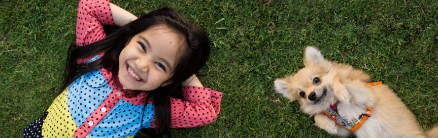 girl_child_and_dog_on_organic_lawn